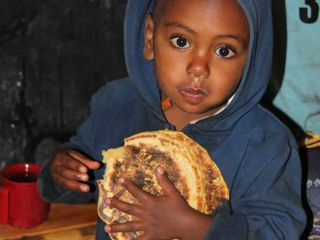 young-boy-receiving-nutritious-food.jpg