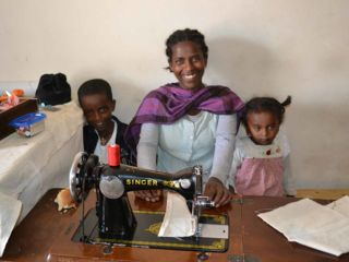happy-woman-and-children-at-sewing-machine.jpg