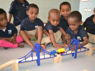 playing-with-wood-train-set-with-bridge.jpg