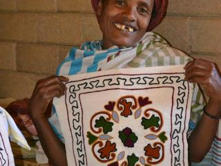korah-woman-showing-her-embroidery.jpg