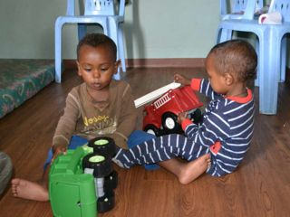 boys-playing-with-trucks.jpg