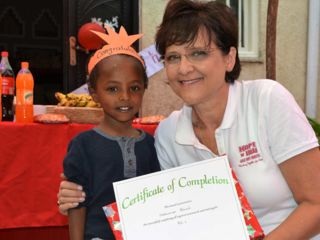 Eve-with-kindergarten-graduate-at-celebration.jpg