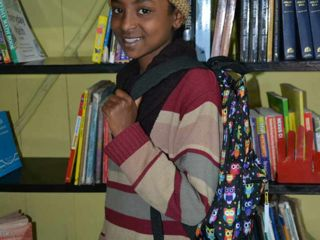 Korah-student-with-new-backpack.jpg