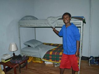 young-man-by-bunk-beds.jpg